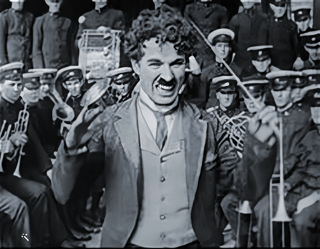 charlie conducting a band at the hippodrome